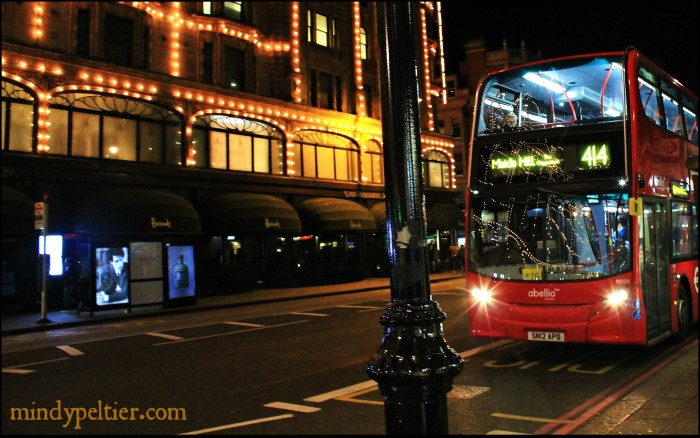 Night Lights of Harrods Reflected on a London city bus. Photo by @MindyJPeltier
