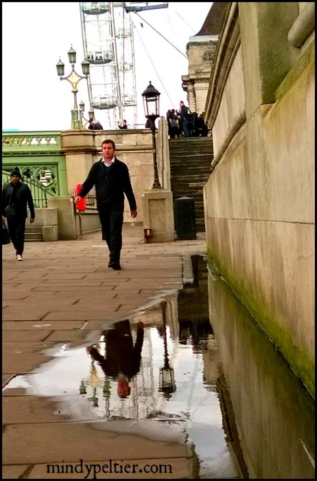 Reflections of a Man in a London puddle. Photo by @MindyJPeltier